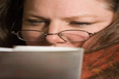 Woman Reading with reading glasses__1416219865_212.67.122.150